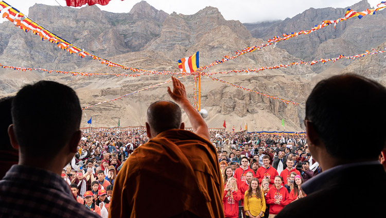 His Holiness the Dalai Lama waving to the gathered crowd on his arrival at Spring Dales Public School in Mulbekh, Ladakh, J&K, India on July 26, 2018. Photo by Tenzin Choejor