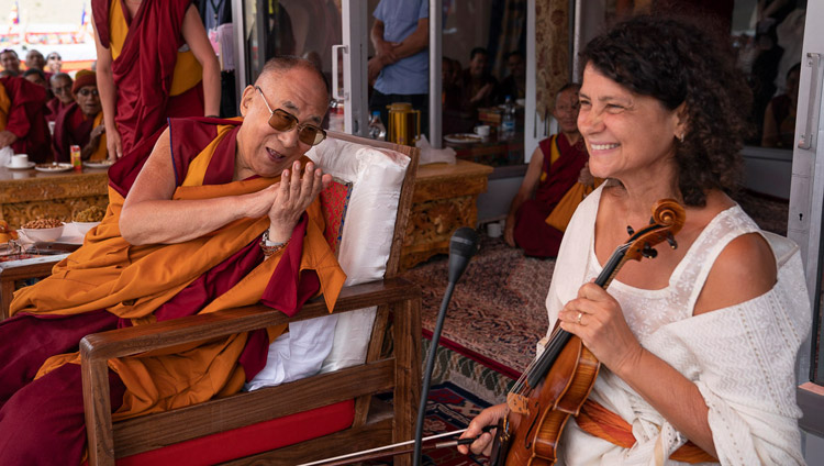 His Holiness the Dalai Lama thanking Czech musician Iva Bittova for her performance at the conclusion of his talk at Spring Dales Public School in Mulbekh, Ladakh, J&K, India on July 26, 2018. Photo by Tenzin Choejor