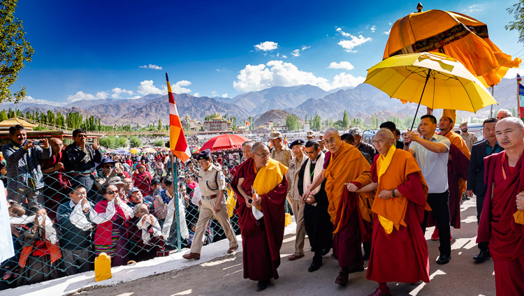 His Holiness the Dalai Lama walking from his residence to the Shewatsel Teaching Ground on the first day of his two day teaching in Leh, Ladakh, J&K, India on July 30, 2018. Photo by Tenzin Choejor