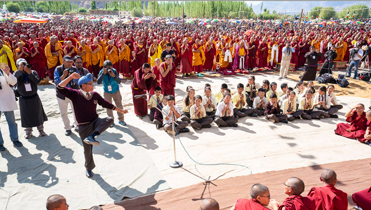 Students from Ladakh Public School demonstrating philosophical debate as His Holiness the Dalai Lama arrives at the Shewatsel Teaching Ground on the first day of his two day teaching in Leh, Ladakh, J&K, India on July 30, 2018. Photo by Tenzin Choejor