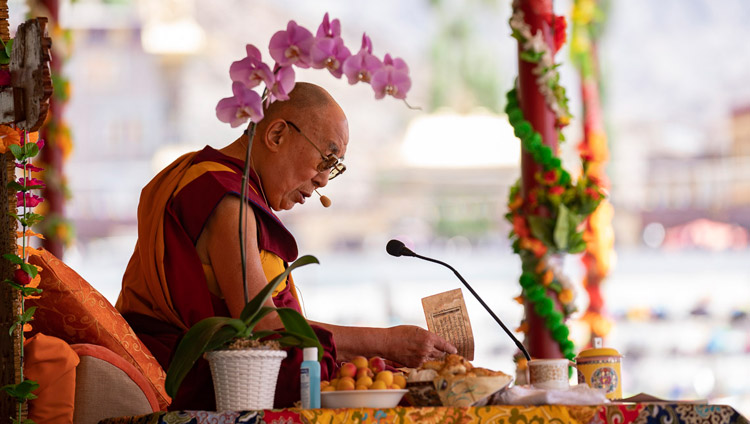 "His Holiness the Dalai Lama reading from Shantideva's ""Guide to a Bodhisattva's Way of Life"" on the first day of his two day teaching in Leh, Ladakh, J&K, India on July 30, 2018. Photo by Tenzin Choejor"