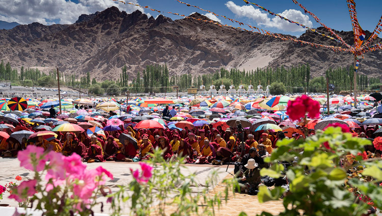 Many of the more than 20,000 attending His Holiness the Dalai Lama's teaching protect themselves from the sun at the Shewatsel Teaching Ground in Leh, Ladakh, J&K, India on July 30, 2018. Photo by Tenzin Choejor