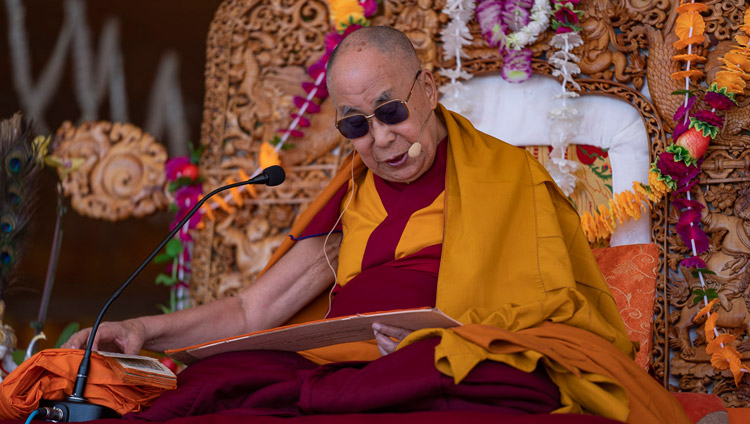 His Holiness the Dalai Lama reading from 'Guide to the Bodhisattva's Way of Life' during the final day of his teachings in Leh, Ladakh, J&K, India on July 31, 2018. Photo by Tenzin Choejor