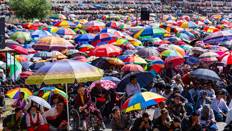 Most of the estimated 30,000 people attending the final day of His Holiness the Dalai Lama's teachings protecting themselves from the sun under umbrellas at the Shewatsel Teaching Ground in Leh, Ladakh, J&K, India on July 31, 2018. Photo by Tenzin Choejor