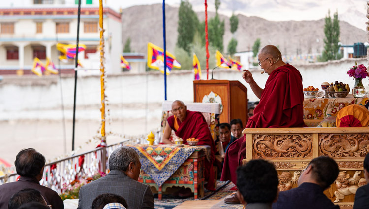 Thiksey Rinpoche looks on as His Holiness the Dalai Lama addresses the crowd of Tibetans, young and old, at Tibetan Children's Village School Choglamsar in Leh, Ladakh, J&K, India on August 1, 2018. Photo by Tenzin Choejor