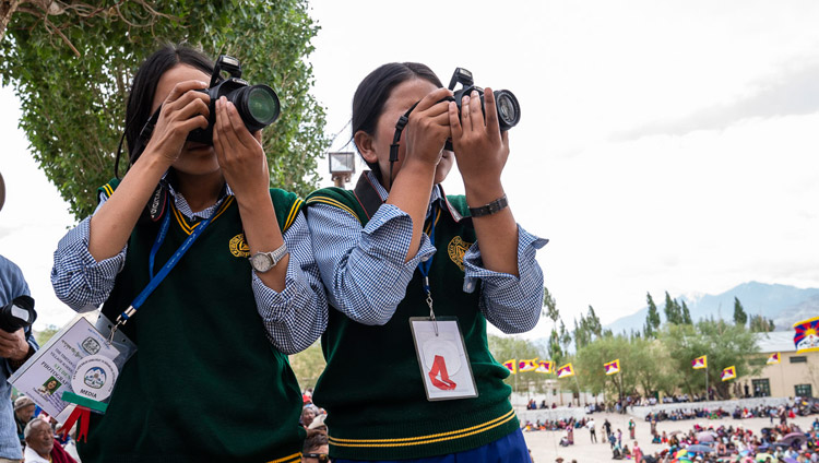 Members of the TCV Photography Club taking photos during His Holiness the Dalai Lama's talk at Tibetan Children's Village School Choglamsar in Leh, Ladakh, J&K, India on August 1, 2018. Photo by Tenzin Choejor