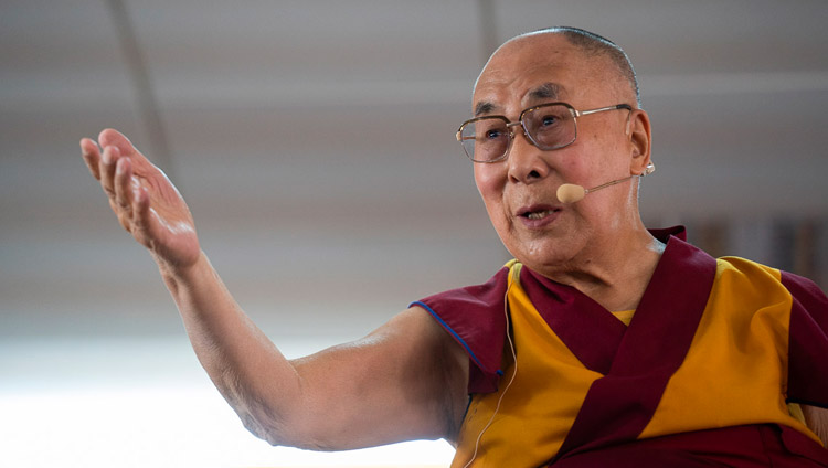 His Holiness the Dalai Lama gestures as he answers questions from the audience during his talk at Eliezer Joldan Memorial College in Leh, Ladakh, J&K, India on August 2, 2018. Photo by Tenzin Choejor