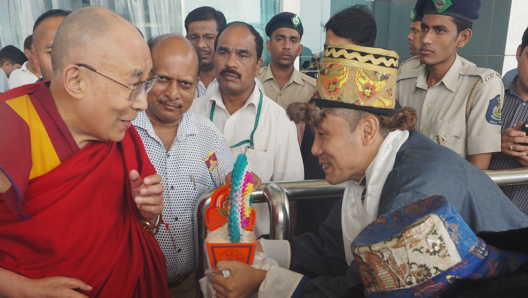His Holiness the Dalai Lama receiving a traditional welcome on his arrival at the airport in Dabolim, Goa, India on August 7, 2018. Photo by Jeremy Russell