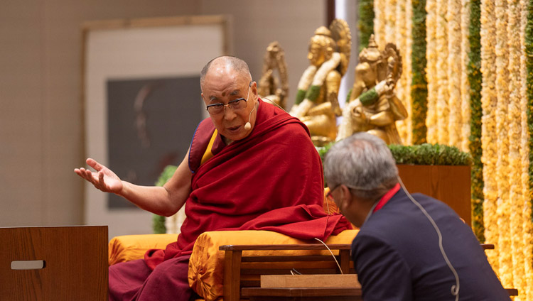 His Holiness the Dalai Lama explaining a point in Tibetan to his English language interpreter during his talk on 'Indian Wisdom and the Modern World' in Bengaluru, Karnataka, India on August 12, 2018. Photo by Tenzin Choejor