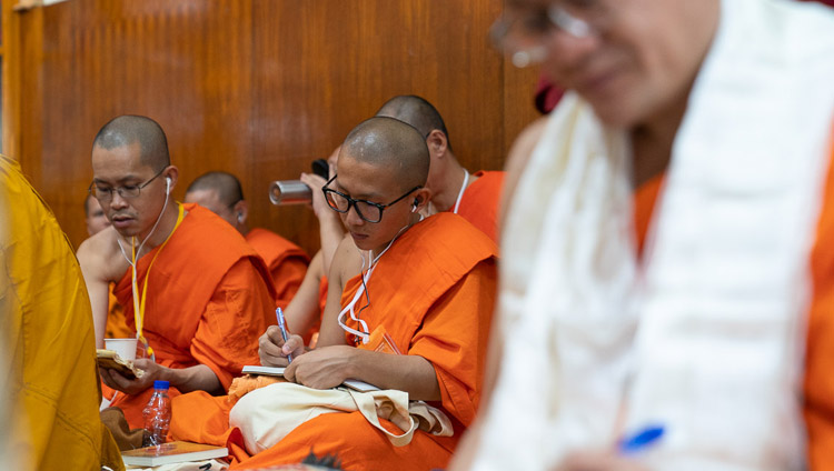 Members of the Thai monastic community taking notes during His Holiness the Dalai Lama's teaching at the Main Tibetan Temple in Dharamsala, HP, India on September 4, 2018. Photo by Tenzin Choejor