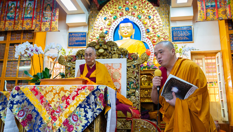 A question from the audience being read for His Holiness the Dalai Lama to answer during his teaching at the Main Tibetan Temple in Dharamsala, HP, India on September 4, 2018. Photo by Tenzin Choejor