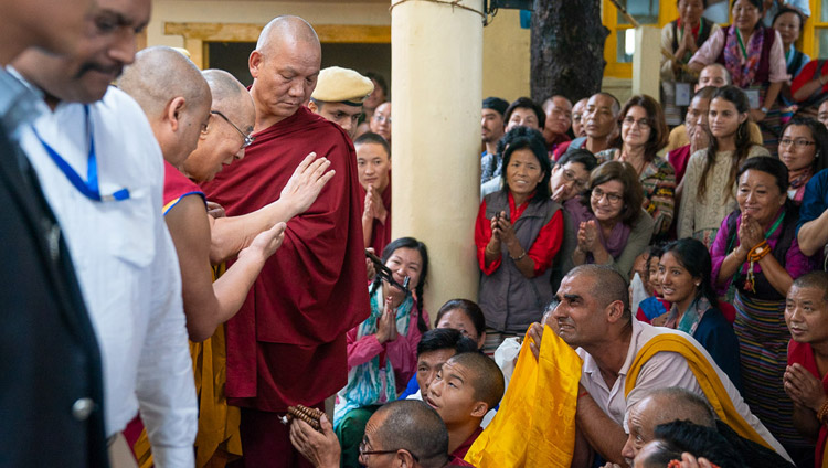 His Holiness the Dalai Lama greeting members of the audience sitting outside the Main Tibetan Temple as he departs for his residence at the conclusion of the first day of his teaching in Dharamsala, HP, India on September 4, 2018. Photo by Tenzin Choejor