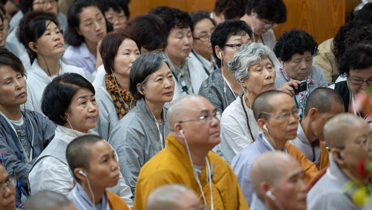 Members of the groups from Southeast Asia listening to His Holiness the Dalai Lama speaking on the second day of his teachings at the Main Tibetan Temple in Dharamsala, HP, India on September 5, 2018. Photo by Tenzin Choejor