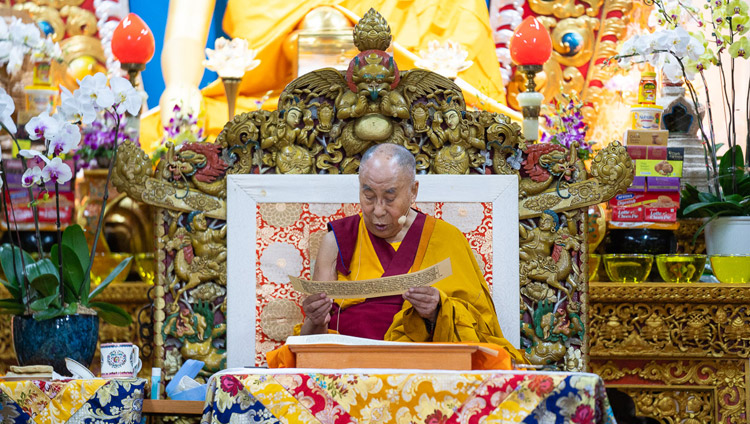 His Holiness the Dalai Lama reading from the text on the second day of his teachings at the Main Tibetan Temple in Dharamsala, HP, India on September 5, 2018. Photo by Lobsang Tsering
