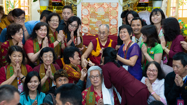 His Holiness the Dalai Lama posing for one of many group photos with members of the audience from East and Southeast Asia at the conclusion of his teachings at the Main Tibetan Temple in Dharamsala, HP, India on September 7, 2018. Photo by Tenzin Choejor