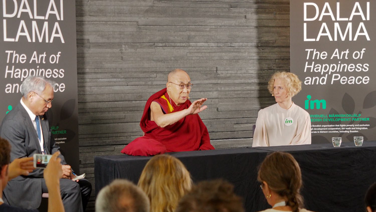 Secretary General of IM Ann Svensén looks on as His Holiness the Dalai Lama addresses members of the press in Malmö, Sweden on September 12, 2018. Photo by Jeremy Russell