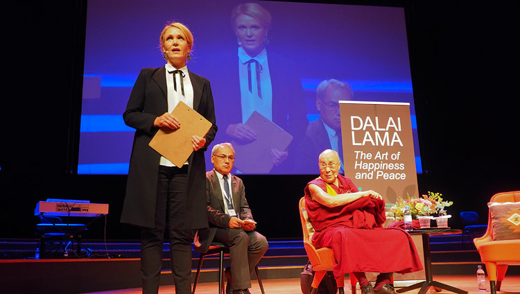 Swedish journalist and television presenter Kattis Ahlstrom introducing His Holiness the Dalai Lama at the start of the program at the Malmö Live in Malmö, Sweden on September 12, 2018. Photo by Jeremy Russell