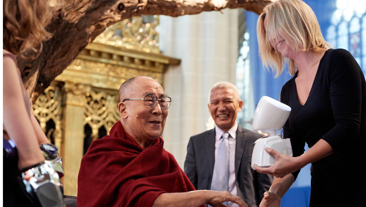 His Holiness the Dalai Lama interacting with AV1, the world's first telepresence robot, during the discussion on 'Robotics and Telepresence' at the Nieuwe Kerk in Amsterdam, Netherlands on September 15, 2018. Photo by Olivier Adam