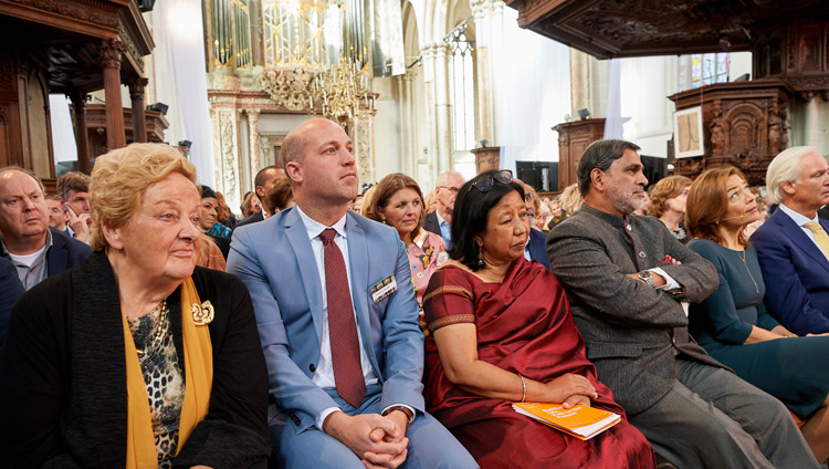 Members of the audience attending listening to His Holiness the Dalai Lama as speaks during the discussion on 'Robotics and Telepresence' at the Nieuwe Kerk in Amsterdam, Netherlands on September 15, 2018. Photo by Olivier Adam