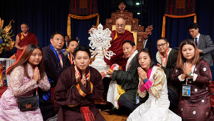 The Tibetan Community in the Netherlands presenting His Holiness the Dalai Lama with elaborate silver Dharma Wheel as token of gratitude at the conclusion of his meeting with Tibetans at the Ahoy convention centre in Rotterdam, Netherlands on September 16, 2018. Photo by Olivier Adams