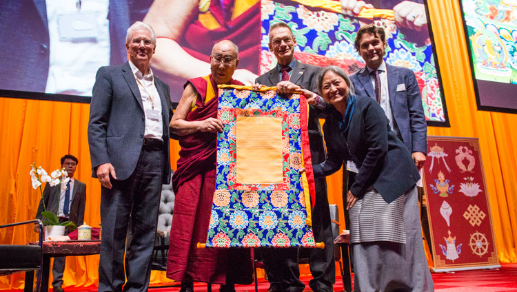 His Holiness the Dalai Lama and members of the International Campaign for Tibet (ICT) holding a certificate denoting the financial grant ICT will give to the Dalai Lama Institute for Higher Education as a gift of gratitude to His Holiness during their program at the Ahoy convention centre in Rotterdam, Netherlands on September 16, 2018. Photo by Jurjen Donkers