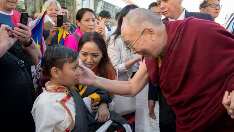 His Holiness the Dalai Lama greeting a young boy as he arrives at his hotel in Darmstadt, Germany on September 18, 2018. Photo by Manuel Bauer