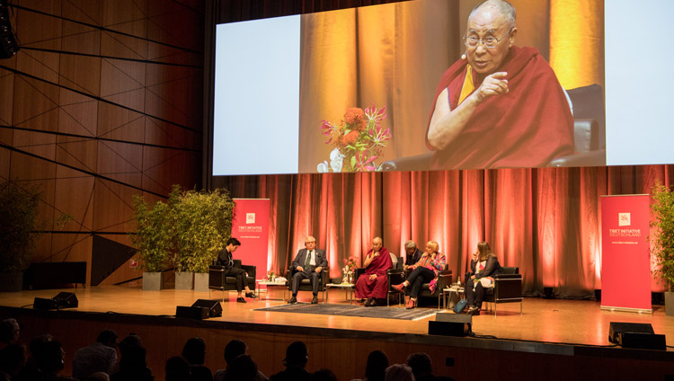 His Holiness the Dalai Lama responding to questions from moderator Dunja Hayali during the discussion on non-violence at Darmstadtium Congress Hall in Darmstadt, Germany on September 19, 2018. Photo by Manuel Bauer