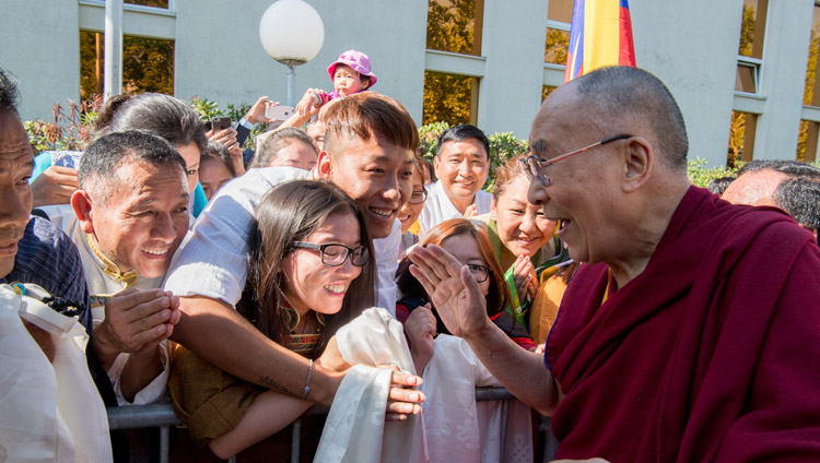 His Holiness the Dalai Lama interacting with members of the Tibetan community gathered at his hotel to welcome him on his arrival in Zurich, Switzerland on September 20, 2018. Photo by Manuel Bauer