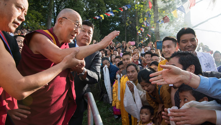 His Holiness the Dalai Lama waving to the crowd of Tibetans gathered to welcome him to Tibet Institute Rikon in Rikon, Switzerland on September 21, 2018. Photo by Manuel Bauer