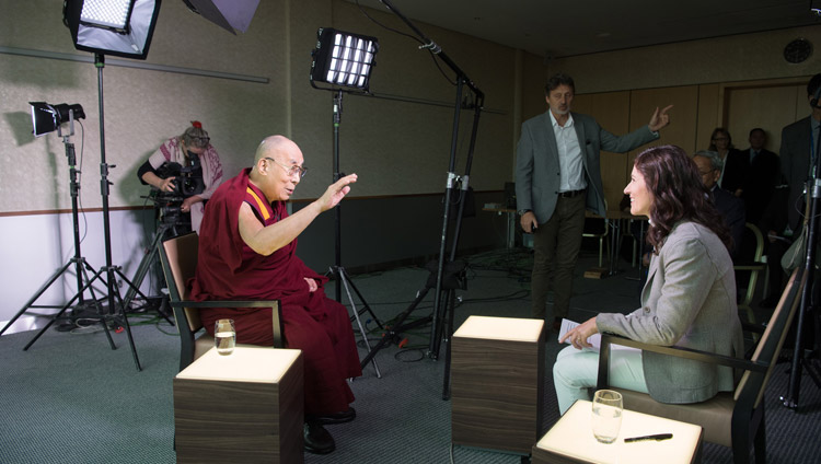 Islamic scholar and journalist Amira Hafner-Al Jabaji interviewing His Holiness the Dalai Lama for Swiss television in Zurich, Switzerland on September 22, 2018. Photo by Manuel Bauer