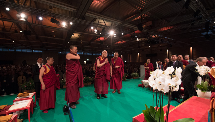 His Holiness the Dalai Lama paying his respects to the image of the Buddha as he arrives on stage at Eulachhalle in Winterthur, Switzerland on September 22, 2018. Photo by Manuel Bauer
