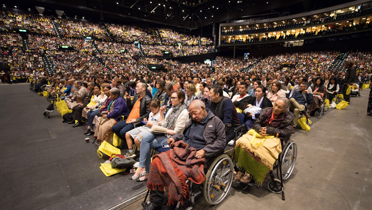 A view of many of the more than 9,000 people attending His Holiness the Dalai Lama's teaching at the Zurich Hallenstadion in Zurich, Switzerland on September 23, 2018. Photo by Manuel Bauer