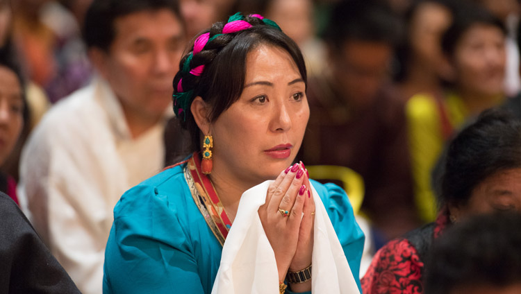 A member of the audience of more than 6,000 Tibetans and Tibet supporters, listening the His Holiness the Dalai Lama during their meeting at the Zurich Hallenstadion in Zurich, Switzerland on September 23, 2018. Photo by Manuel Bauer