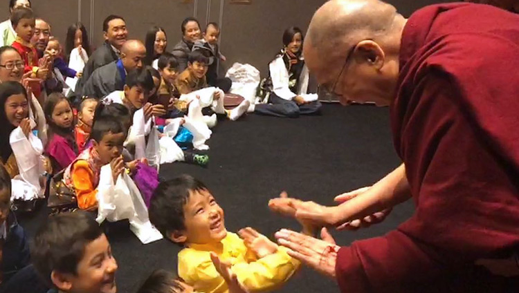 His Holiness the Dalai Lama playfully greeting young children as he arrives for his meeting with members of the Tibetan community and Tibet support groups in Malmö, Sweden on September 13, 2018. Photo by Tseten Samdup