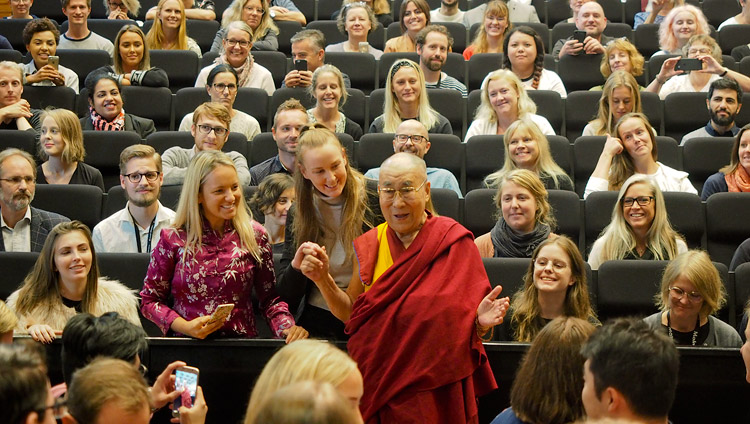 His Holiness the Dalai Lama posing for photos with members of the audience after his talk to students at Malmö University in Malmö, Sweden on September 13, 2018. Photo by Jeremy Russell