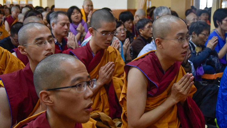 Members of the audience from Taiwan inside the Main Tibetan Temple reciting prayers at the start of His Holiness the Dalai Lama's teaching in Dharamsala, HP, India on October 3, 2018. Photo by Tenzin Phende/DIIR
