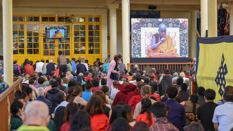 Many of the crowd gathered in the Main Tibetan Temple courtyard watching His Holiness the Dalai Lama's teaching on big screens in Dharamsala, HP, India on October 3, 2018. Photo by Tenzin Phende/DIIR