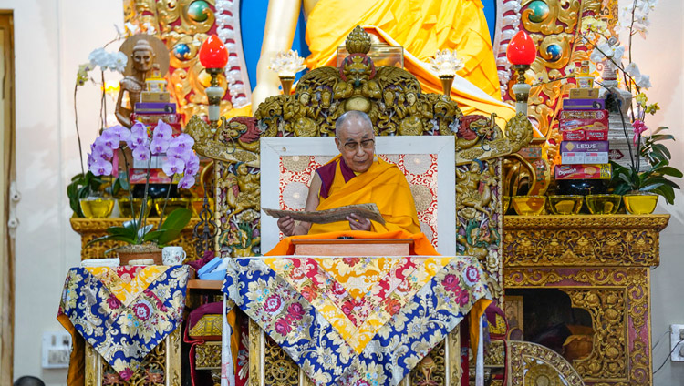 "His Holiness the Dalai Lama reading from Chandrakirti's ""Entering into the Middle Way"" on the third day of teachings at the Main Tibetan Temple in Dharamsala, HP, India on October 5, 2018. Photo by Ven Tenzin Jamphel"