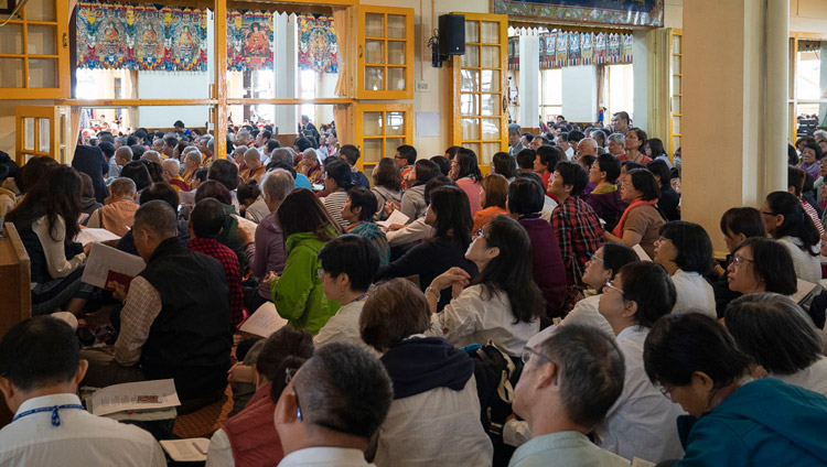 Members of the audience following the text on the final day of His Holiness the Dalai Lama's teaching at the Main Tibetan Temple in Dharamsala, HP, India on October 6, 2018. Photo by Ven Tenzin Jamphel
