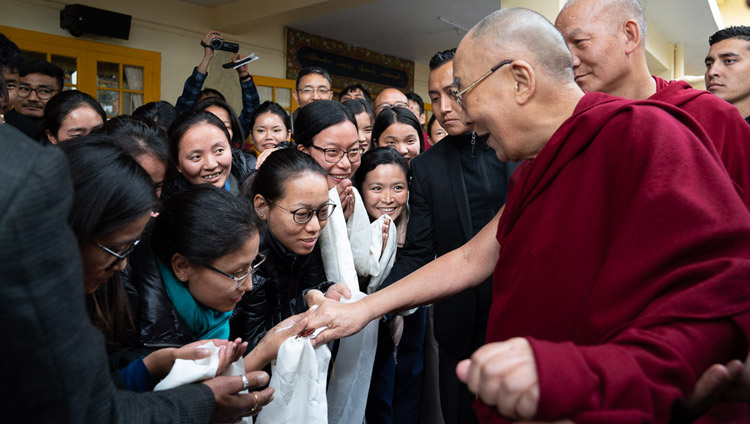 His Holiness the Dalai Lama interacting with members of the audience as he departs from the Main Tibetan Temple for his residence at the conclusion of the second day of the dialogue with Chinese scientists on quantum effects in Dharamsala, HP, India on November 2, 2018. Photo by Ven Tenzin Jamphel