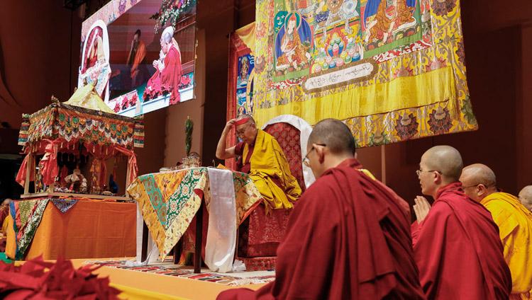 His Holiness the Dalai Lama performing preparatory procedures for the Avalokiteshvara Empowerment he was to give in Yokohama, Japan on November 15, 2018. Photo by Tenzin Jigme