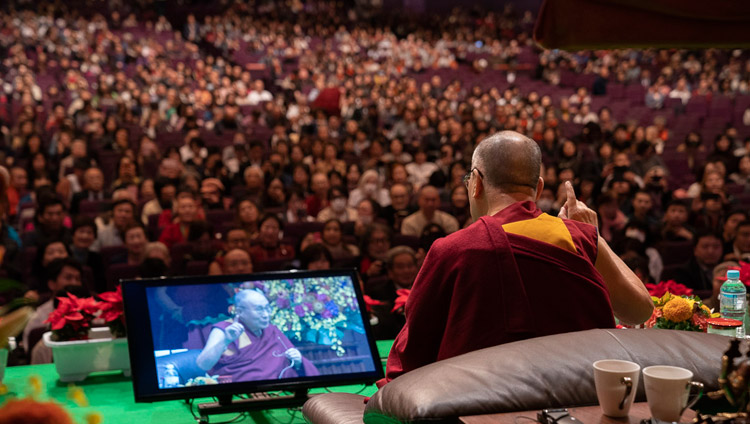 His Holiness the Dalai Lama addressing the audience at the National Convention Hall at the start of the Dialogue between Modern Science and Buddhist Science in Yokohama, Japan on November 16, 2018. Photo by Tenzin Choejor