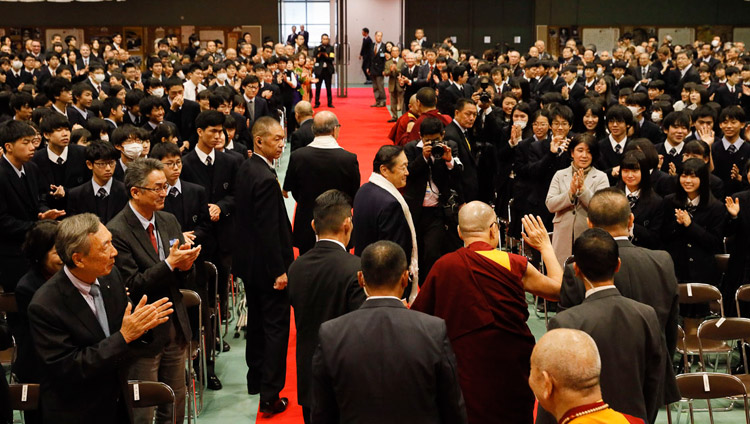 His Holiness the Dalai Lama greeting members of the audience as he makes his way out of the hall after his talk at Reitaku University in Chiba, Japan on November 19, 2018. Photo by Tenzin Jigme