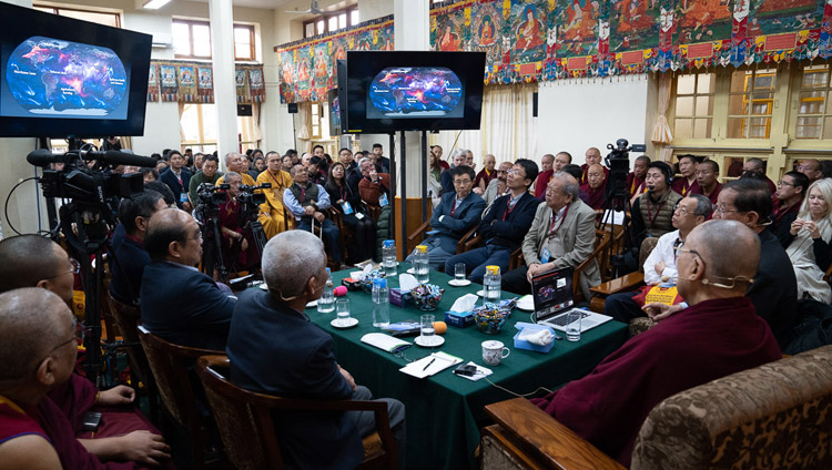 His Holiness the Dalai Lama and fellow participants watching Prof Yuan Tseh Lee's presentation on Challenges and Opportunities for a Sustainable Planet on the third day of the dialogue with Chinese scientists about quantum effects at the Main Tibetan Temple in Dharamsala, HP, India on November 3, 2018. Photo by Ven Tenzin Jamphel