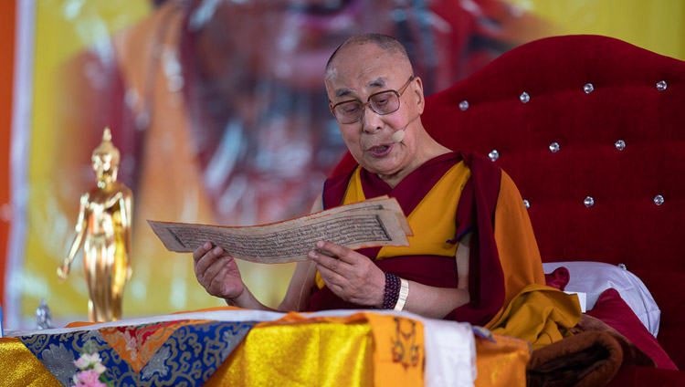 His Holiness the Dalai Lama reading from 'Guide to the Bodhisattva's Way of Life' on the second day of his teaching in Sankisa, UP, India on December 4, 2018. Photo by Lobsang Tsering