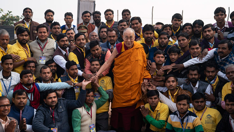 His Holiness the Dalai Lama with Youth Buddhist Society of India volunteers and organizers of his teaching in Sankisa, UP, India on December 5, 2018. Photo by Lobsang Tsering