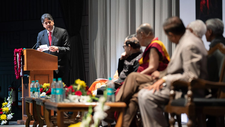 Former TV anchor Vikram Chandra reading a question from the audience for His Holiness the Dalai Lama during the 1st Yuvraj Krishan Memorial Lecture at Siri Fort Auditorium in New Delhi, India on December 8, 2018. Photo by Lobsang Tsering