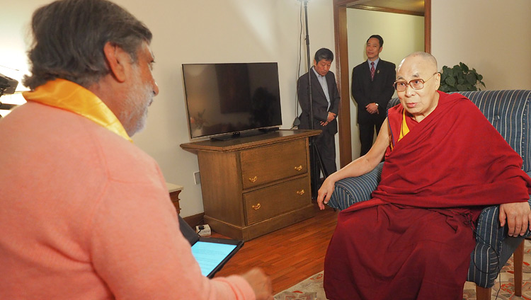 Ramesh Sharma interviewing His Holiness the Dalai Lama for his documentary about Gandhi's message of non-violence in New Delhi, India on December 10, 2018. Photo by Jeremy Russell
