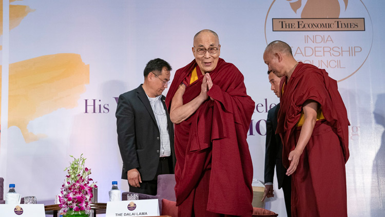 His Holiness the Dalai Lama greeting the audience on his arrival at the Maurya Sheraton Convention Hall to address the  India Leadership Council in New Delhi, India on December 10, 2018. Photo by Tenzin Choejor