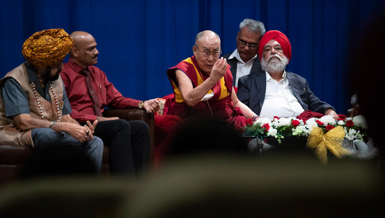 His Holiness the Dalai Lama speaking on compassion at Guru Nanak College in Mumbai, India on December 13, 2018. Photo by Lobsang Tsering
